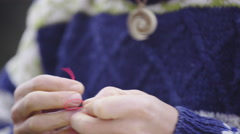 Making a necklace lock mechanism from strings 4K Stock Footage