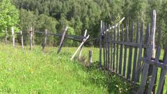 Wooden fence and fence wire mesh that surrounds a property 73 Stock Footage