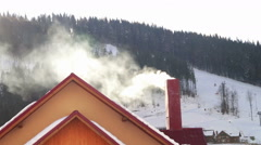 The smoke from the chimney of the house Stock Footage
