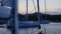Sail boats in bay waiting for night A yacht anchored Stock Footage