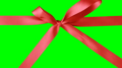 Red Ribbon & Bow With Disentanglement Gift Box With Red Ribbon Opening. Stock Footage
