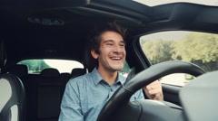 Man exultant full of joy driving car Stock Footage