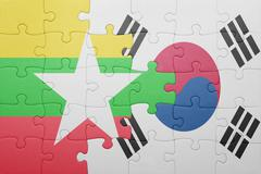 Stock Photo of puzzle with the national flag of myanmar and south korea