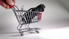 Model car in model shopping trolley - keys added. - stock footage