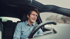 Sad desperate man crying while driving car Stock Footage