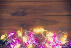 Christmas light on the wooden background - stock photo