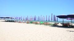 Furniture on Cha am Beach in Phetchaburi, Thailand Stock Footage