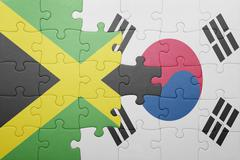 Stock Photo of puzzle with the national flag of jamaica and south korea