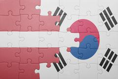 Stock Photo of puzzle with the national flag of latvia and south korea