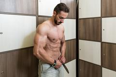 Athlete Changing Clothing in Gym Locker Room Stock Photos