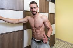 Bodybuilder Changing Clothing in Gym Locker Room Stock Photos