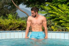 Young Looking Macho Man At Swimming Pool - stock photo