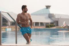 Young Looking Macho Man At Swimming Pool Stock Photos