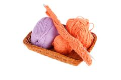 Balls of a yarn knitting in wooden box on white background Stock Photos