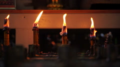 Candles burning in temple faith and belief in religion background Stock Footage