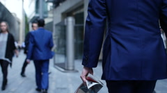 Businessman with magazine in business district in London Stock Footage