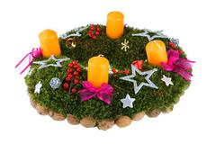 Christmas advent wreath with candles on white background - stock photo