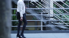 Woman in high heels in business district - stock footage