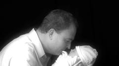 Father Holding Newborn - stock footage