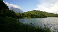 Fishermen in Charco Verde lake Stock Footage