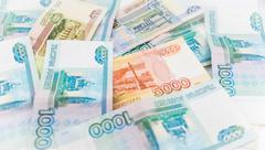 Russian money background. Ruble banknotes of different denominations Stock Photos