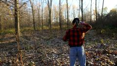 Rear view of senior lumberjack in forest - stock footage
