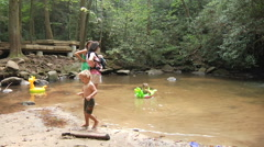 Kids Playing In Creek - stock footage