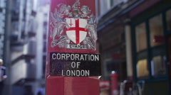 Corporation of London sign and businessman in City - stock footage
