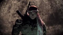 The ominous terrorist with an automatic rifle looks in the camera - stock footage