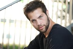 Portrait of a male fashion model with beard - stock photo