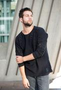 Stock Photo of Male fashion model with beard posing outdoors