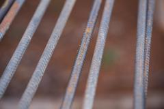 Steel rods or bars used to reinforce concrete - stock photo
