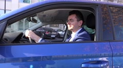 Stock Video Footage of Happy business man in car after meeting with important client giving thumbs up
