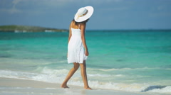 Happy smiling young Latin American girl barefoot on tropical beach Stock Footage
