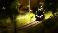 Steam locomotive  with cars toy goes in the child world Stock Footage