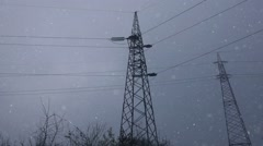 Electricity pylon in snow - stock footage