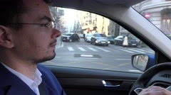Driving to work during the day by car, focused attentive driver in traffic 4K - stock footage