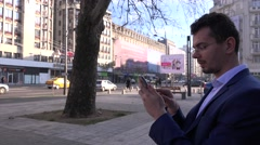 Extremely happy stock trader checking market results on bench outside office 4K Stock Footage