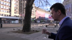 Business man in the city, thirsty in summer season, drinking water, relaxing 4K - stock footage