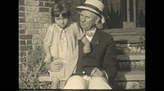 Vintage 16mm film, 1925, US Roaring 20s, people b-roll, grandpa and grandaughter Stock Footage