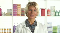 Portrait of a female Pharmacist at work Stock Footage