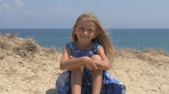 Portrait of Happy Little Girl Looking in Camera on Beach, Child at Seashore - stock footage