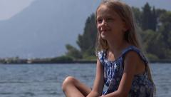 4K Portrait of Happy Laughing Little Girl Looking on Beach, Child at Seashore - stock footage