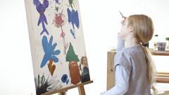 Painting kid white bg 2 Stock Footage