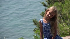 4K Portrait of Happy Little Girl Looking in Camera on Beach, Child at Seashore - stock footage