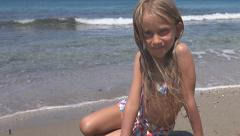 Portrait of Happy Little Girl Looking in Camera on Beach, Child at Seashore Stock Footage