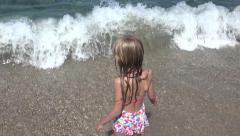 4K Child Playing on Beach Coastline in Waves Little Girl Running Walking Sea Kid - stock footage