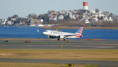 American Airlines takes off, Boston harbor background - stock footage