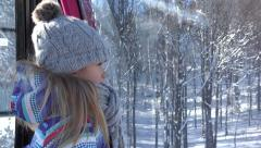 4K Girl in Ski Lift, Winter Mountains View in Alps, Alpine, Child in Cable Car Stock Footage