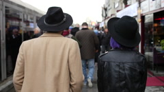 Couple in panama hats on the streets of Istanbul - stock footage